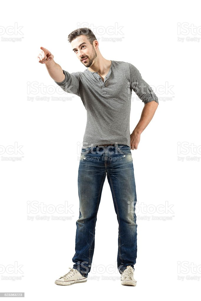 Young man pointing at something or someone in the distance stock photo