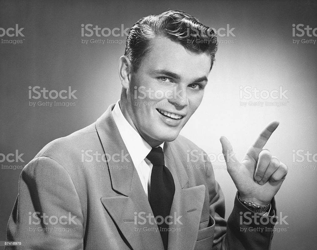 Young man pointing in studio, (B&W), (Close-up), (Portrait) royalty-free stock photo