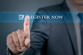 Young man pointing into register now