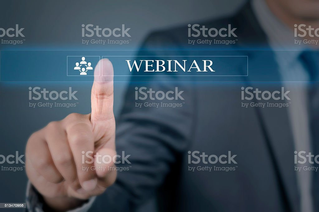 Young man pointing into webinar stock photo