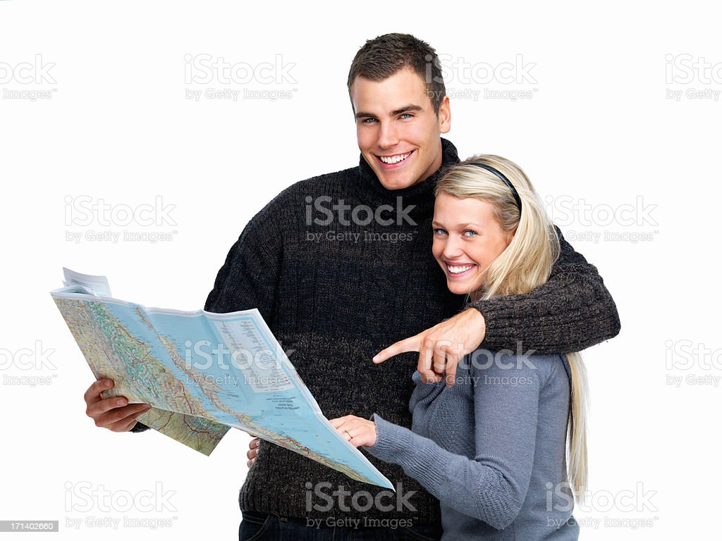 Young man pointing map out to woman royalty-free stock photo