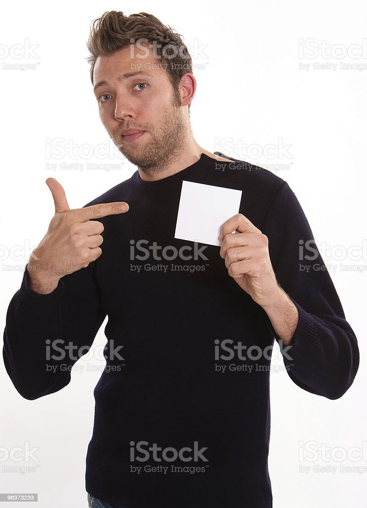 Young man pointing to a blank note royalty-free stock photo