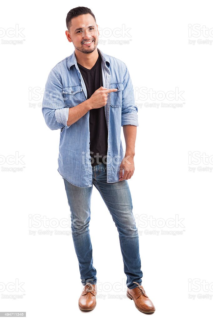 Young man pointing to the side stock photo