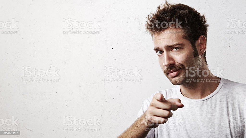 Young man pointing towards the camera stock photo