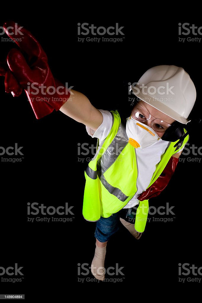 young man pointing up dressed in protective workwear royalty-free stock photo