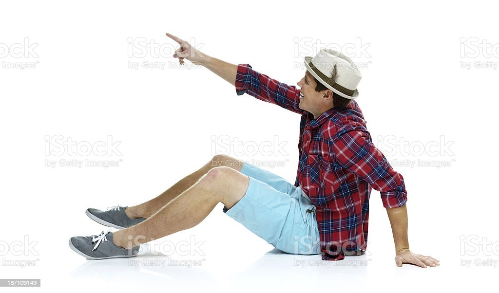 Young man pointing upwards royalty-free stock photo