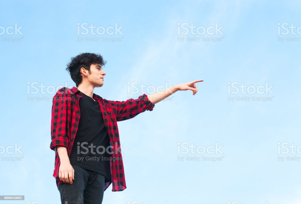 young man pointing with her finger stock photo