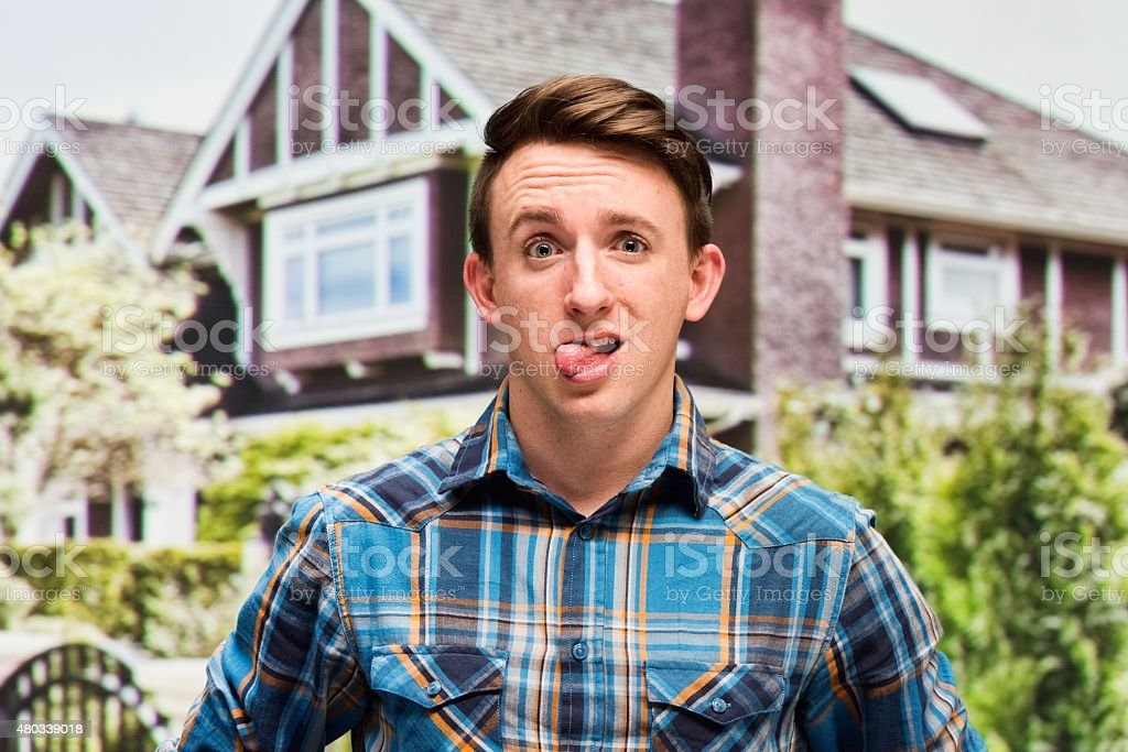 Young man poking tongue out stock photo