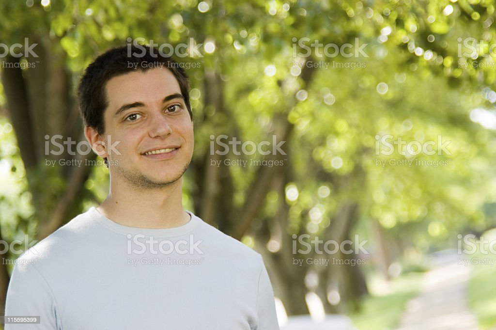 Young man portrait in the park royalty-free stock photo