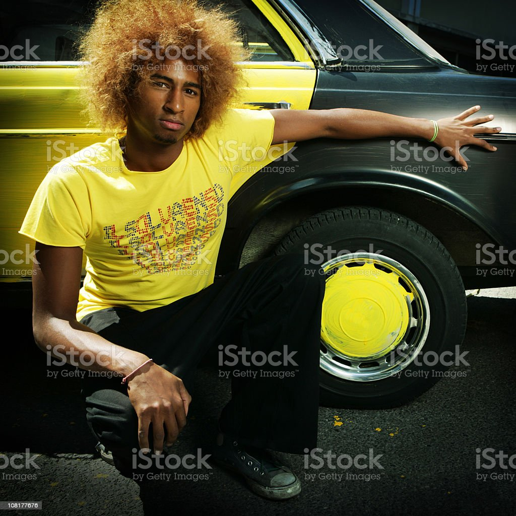 Young Man Posing By Old, Hand Painted Car royalty-free stock photo
