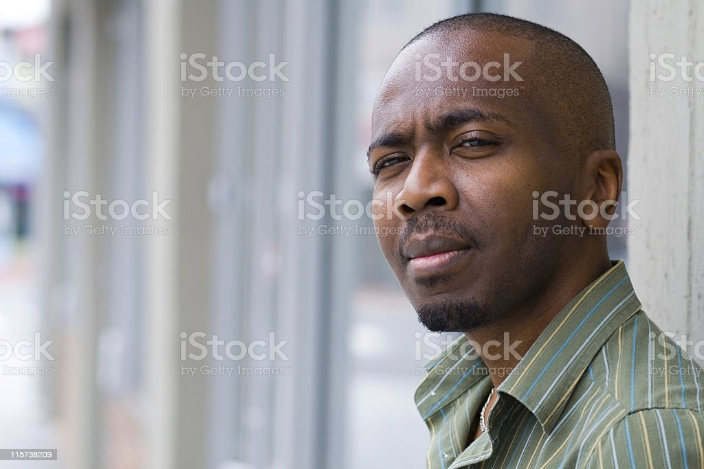 Young man posing for a Camera without a smile stock photo