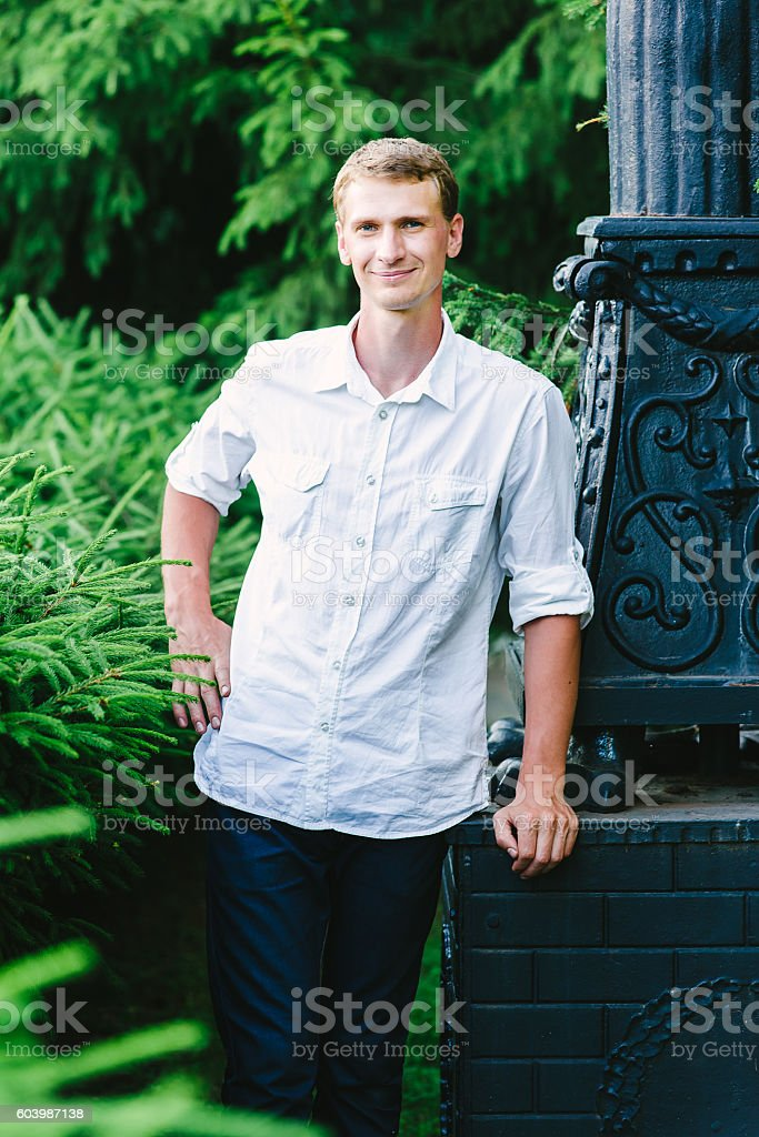 young man posing for a photo, green background stock photo