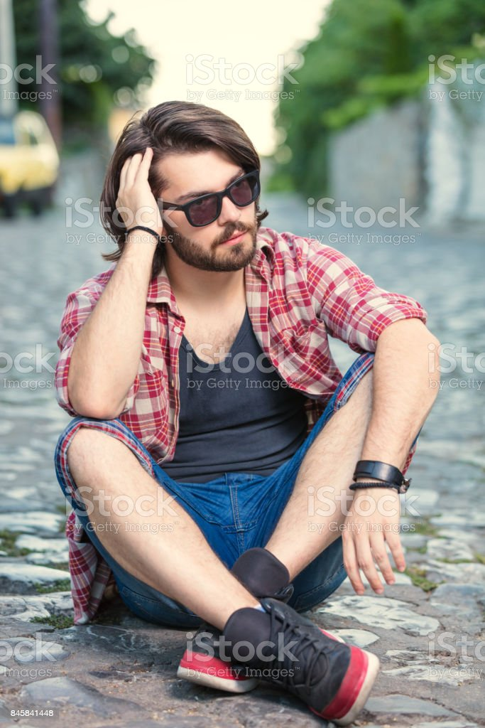 Young man posing in front of the camera. stock photo