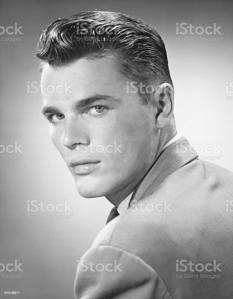 Young man posing in studio, (B&W), (Close-up), (Portrait) stock photo