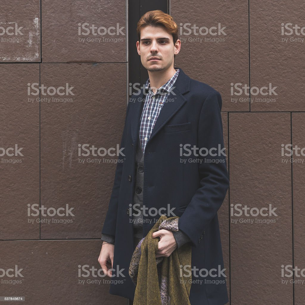 Young man posing in the city streets stock photo