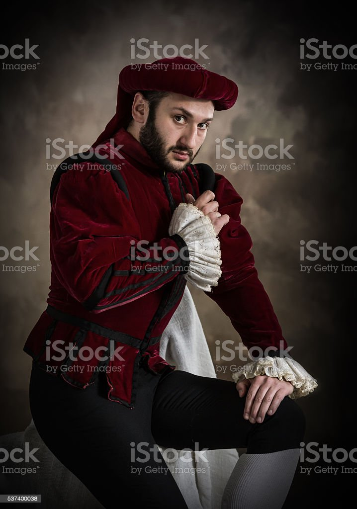 Young man posing in theatrical costume stock photo