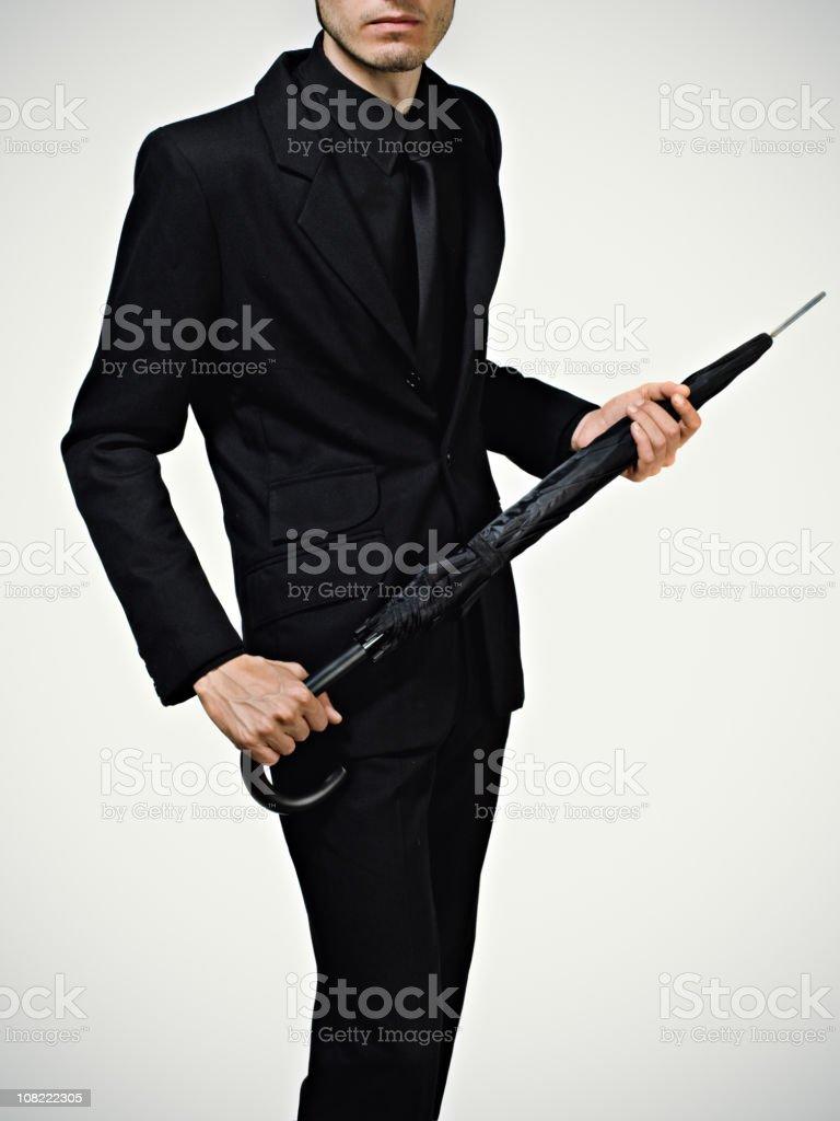 Young man posing umbrella stock photo