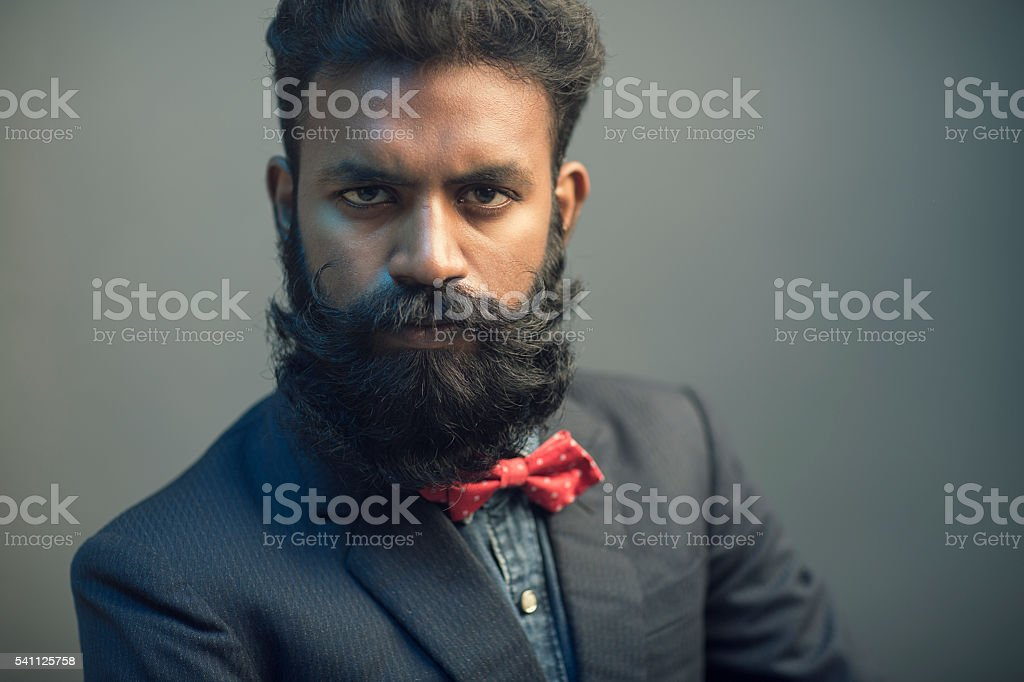 Young man posing with beard in suit stock photo