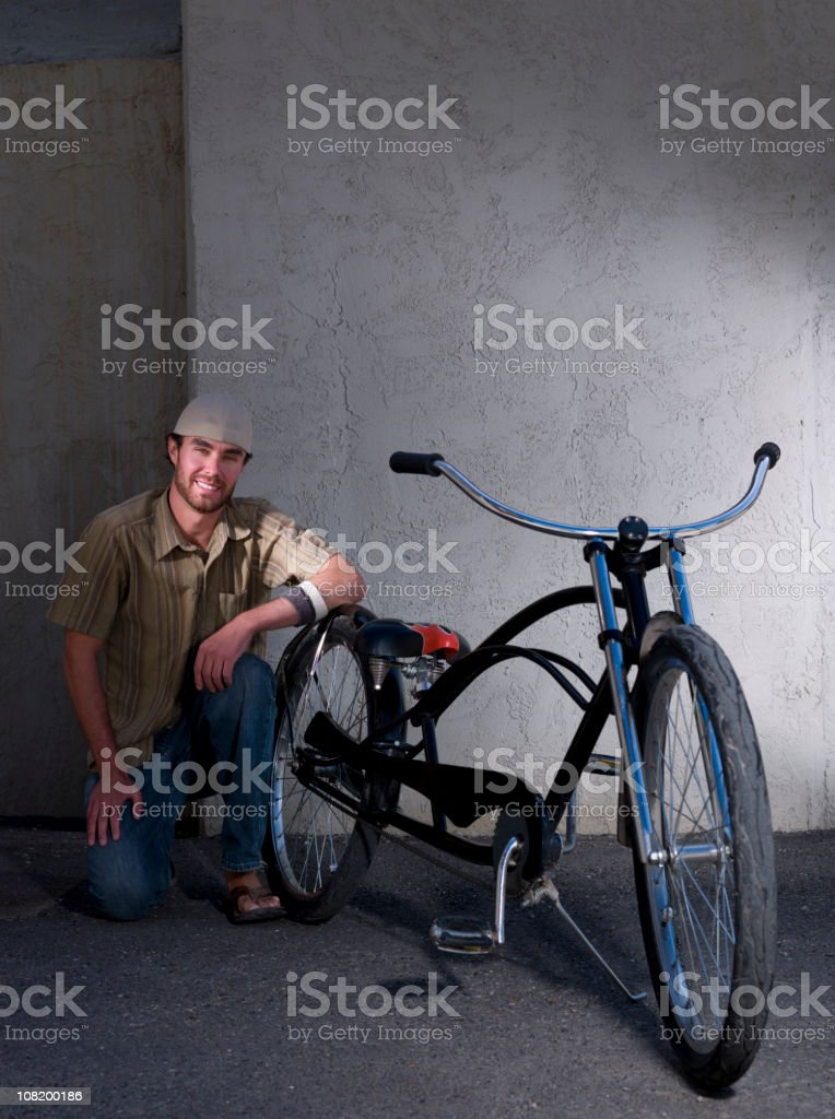 Young Man Posing with Bicycle stock photo