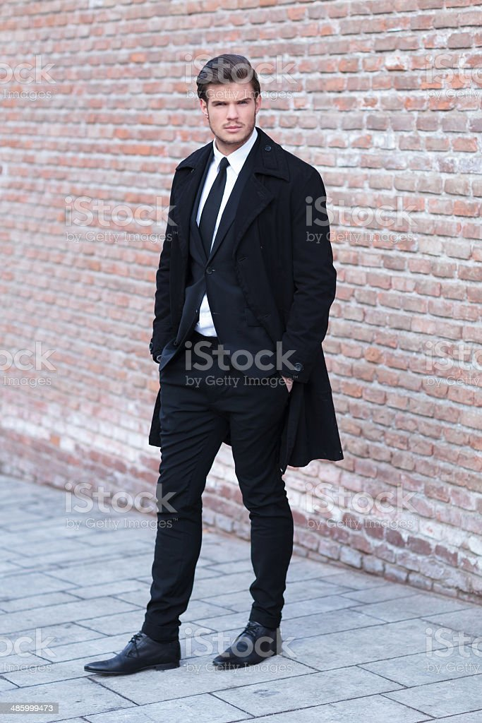 young man posing with hands in pockets stock photo