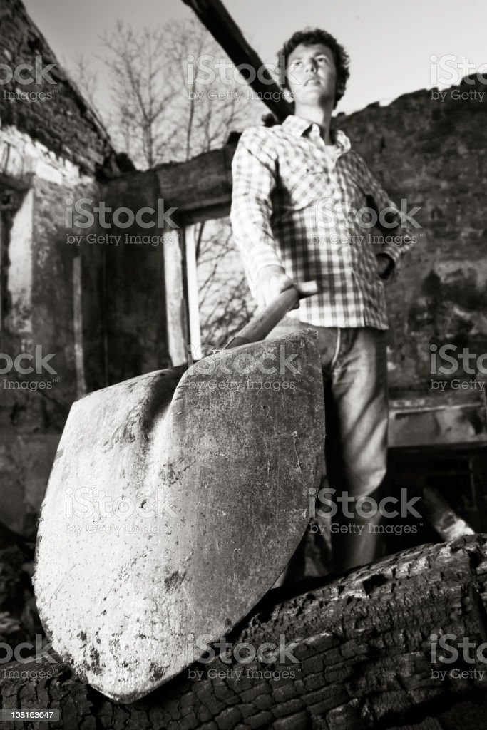 Young Man Posing with Shovel Outside, Black and White royalty-free stock photo