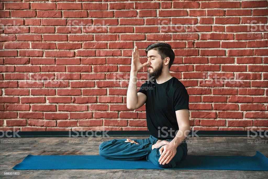 Young man practice yoga stock photo