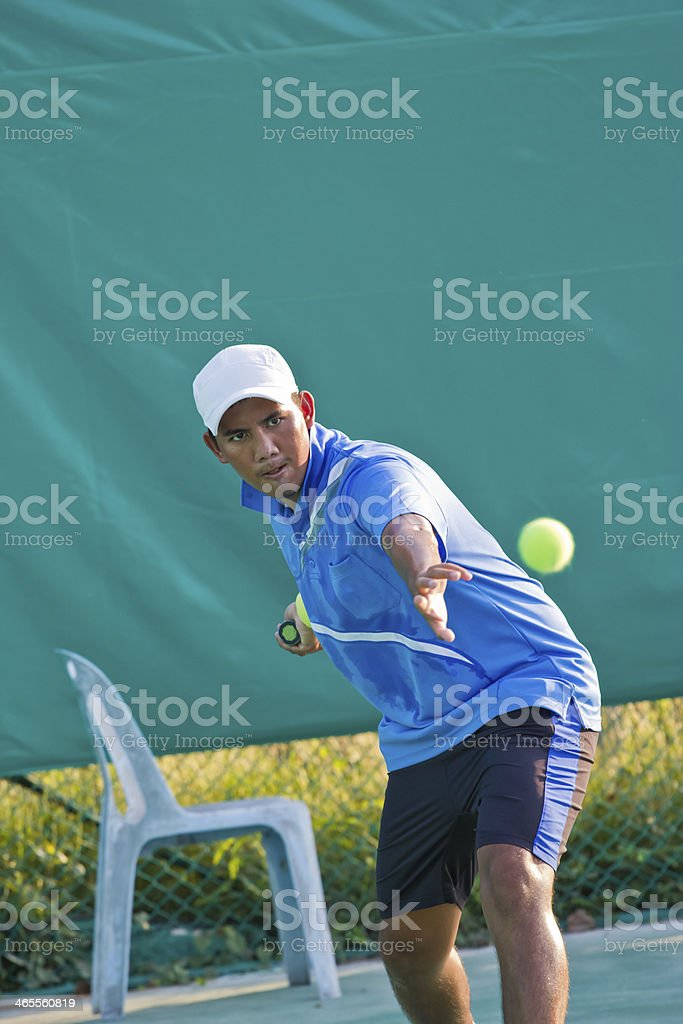 young man practices tennis royalty-free stock photo