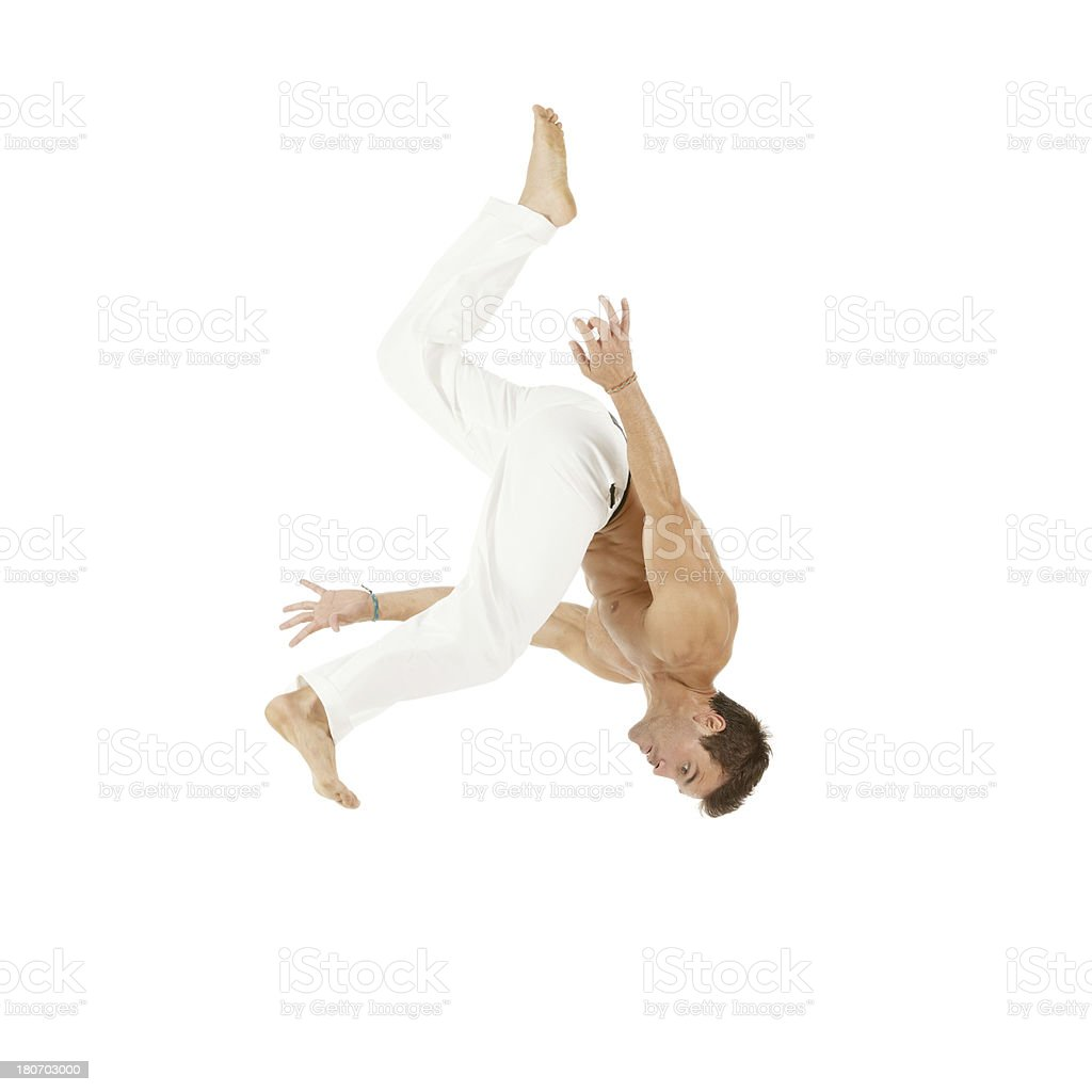 Young man practicing capoeira royalty-free stock photo