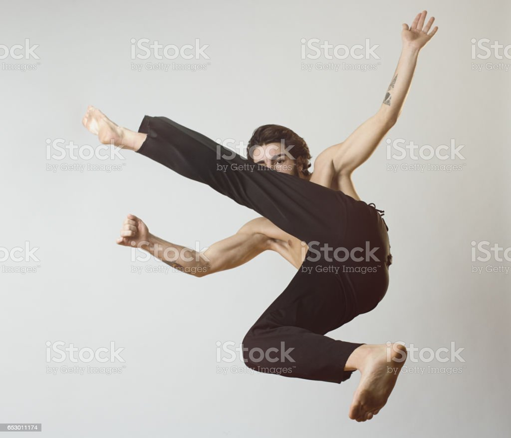 Young man practicing capoeira stock photo