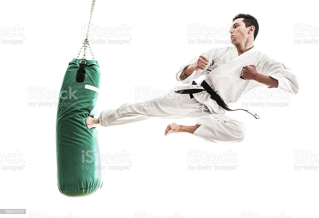 Young man practicing martial arts stock photo