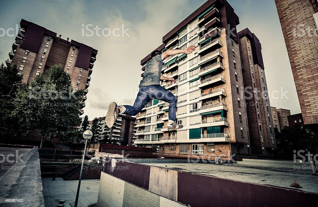 Young man practicing parkour in the city stock photo