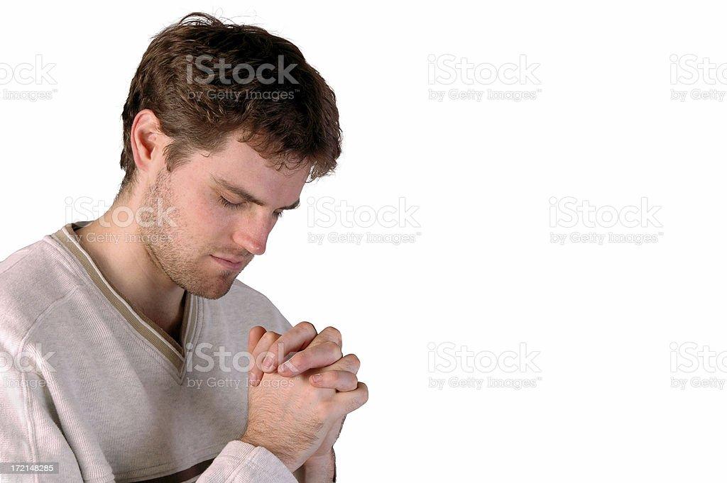Young man praying stock photo