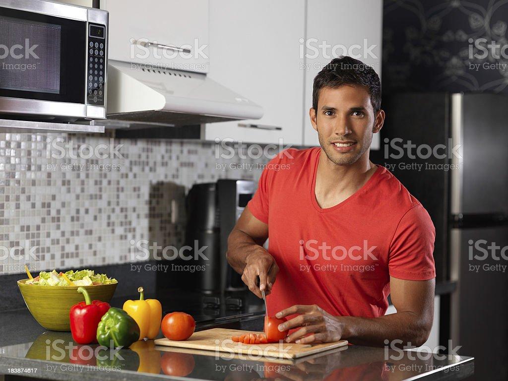 Young man preparing a healthy salad royalty-free stock photo