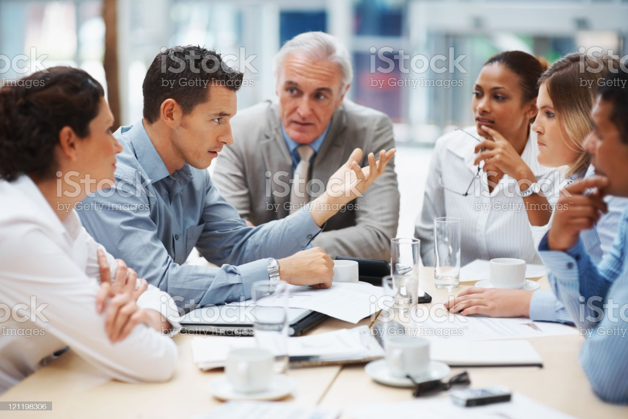 Young man presenting ideas to his business team royalty-free stock photo