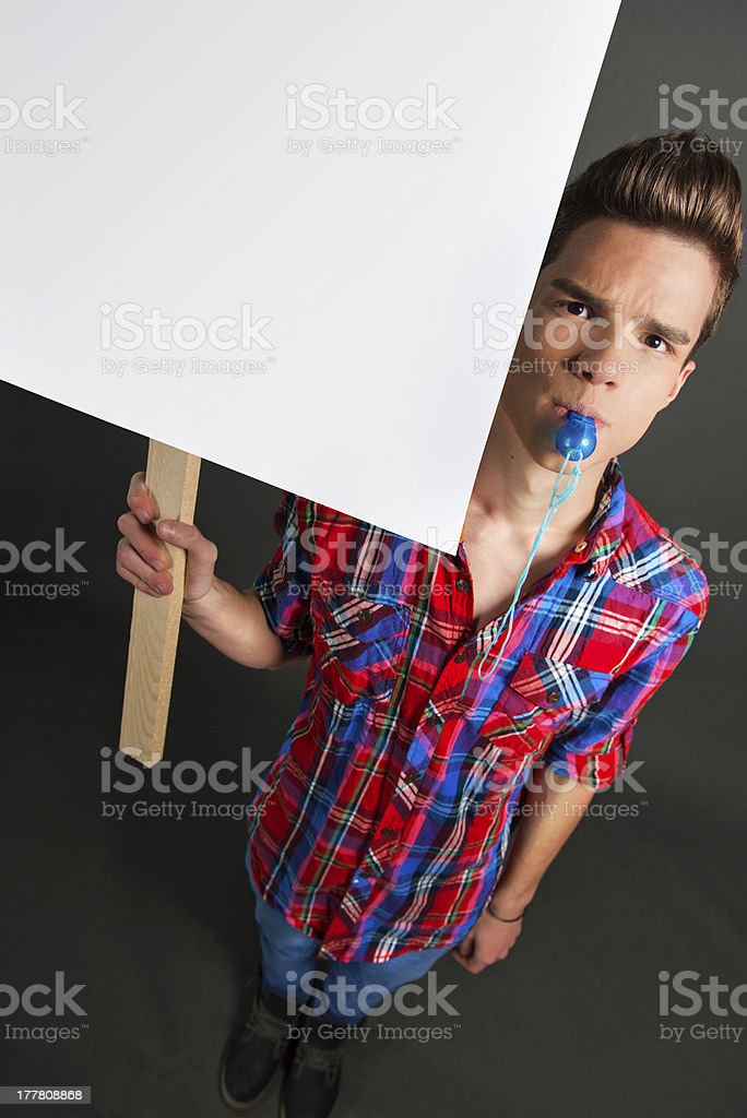 Young man protesting with protest sign royalty-free stock photo