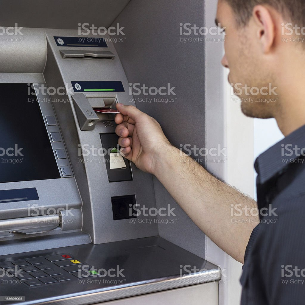 Young man put his credit card stock photo