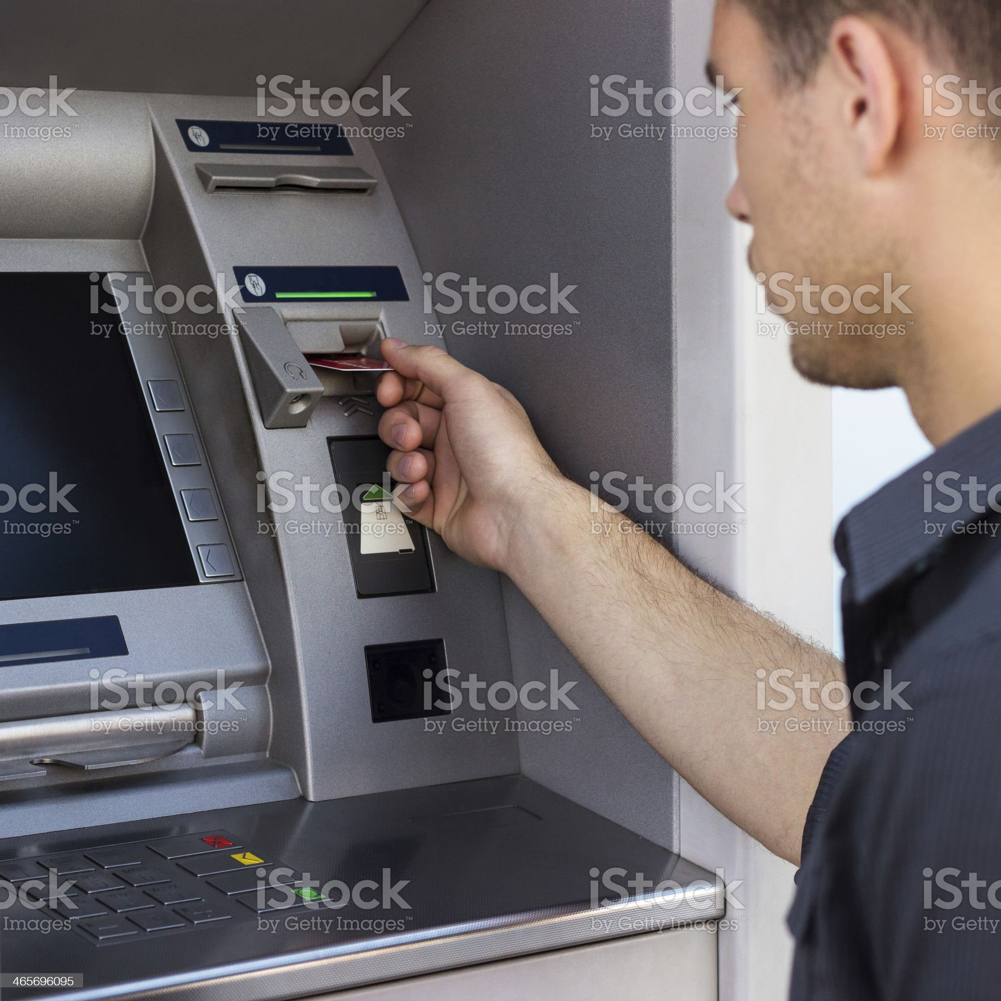 Young man put his credit card royalty-free stock photo