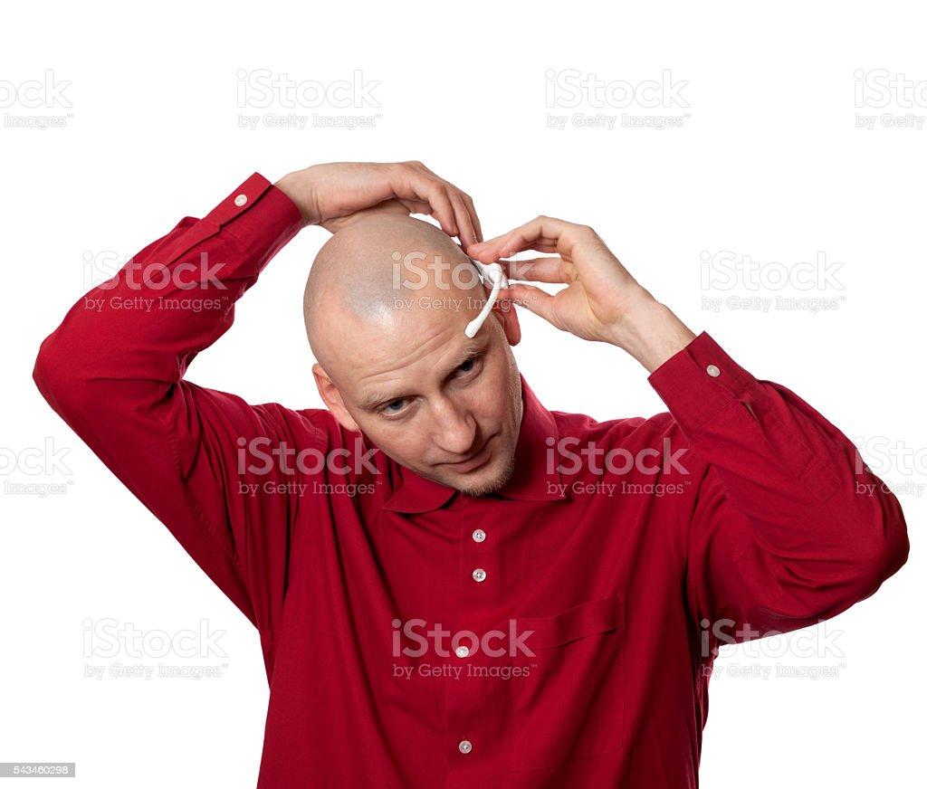Young man puts on head headset EEG (electroencephalography) stock photo