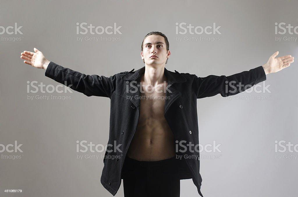 Young man raising his arms up, praying stock photo