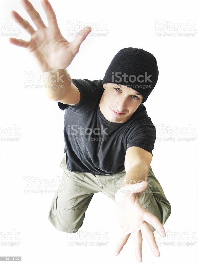 Young man reaching up royalty-free stock photo