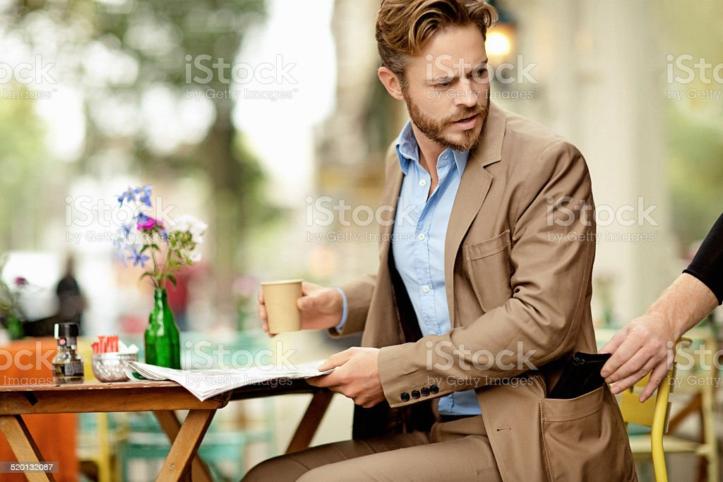 Young man reacts furiously at catching a pickpocket stock photo