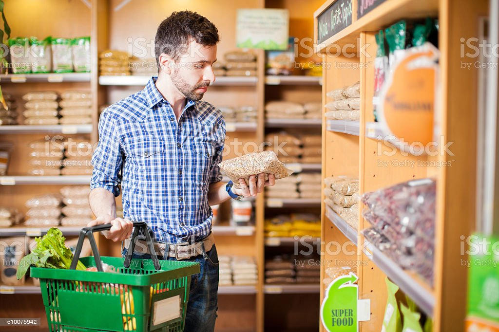 Young man reading a product label stock photo