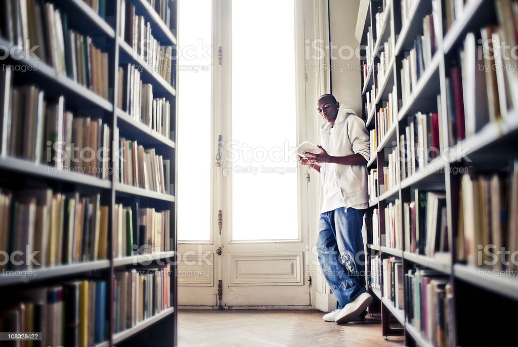 Young Man Reading in a Library royalty-free stock photo