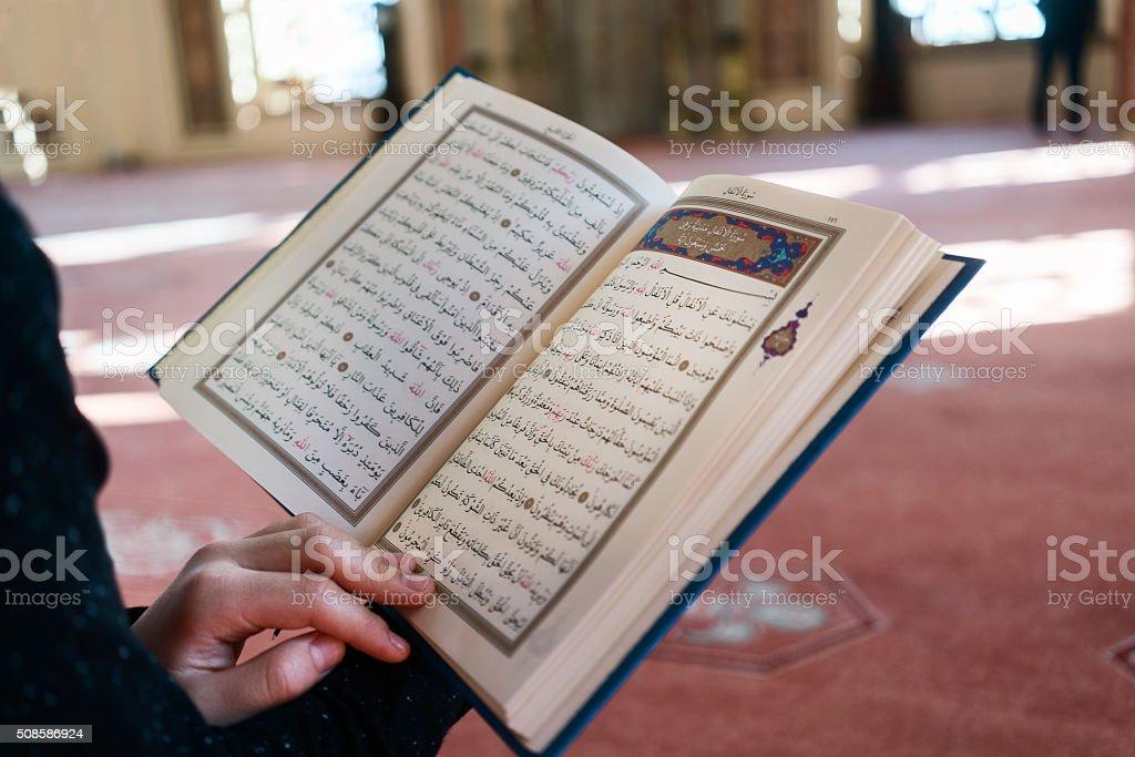 Young man reading the Holy Koran stock photo