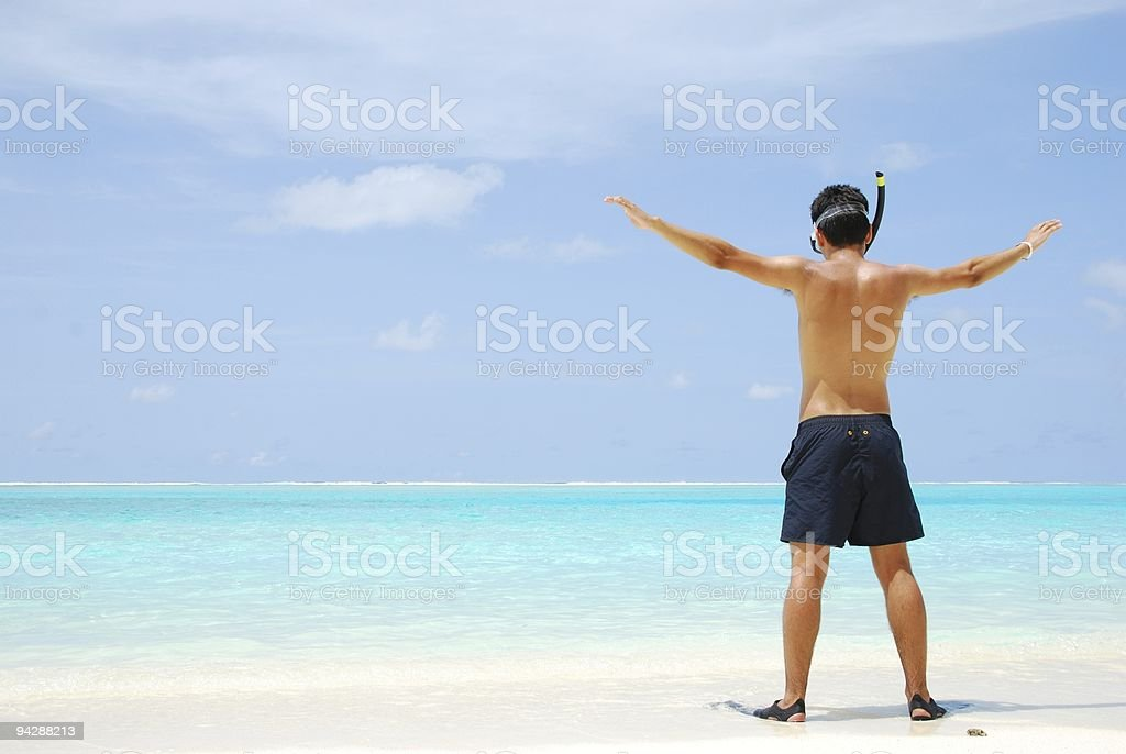 Young man ready to go snorkeling (wide open arms) royalty-free stock photo