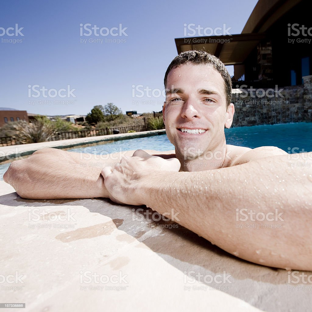 young man relaxing at the swimming pool royalty-free stock photo