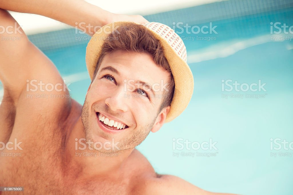 Young Man Relaxing by Poolside stock photo