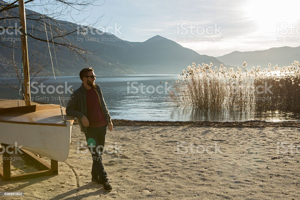 Young man relaxing by the lake, Switzerland stock photo