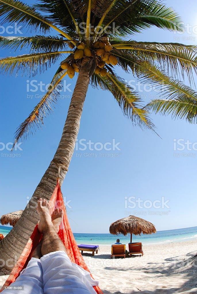 Young man relaxing on a beautiful beach stock photo