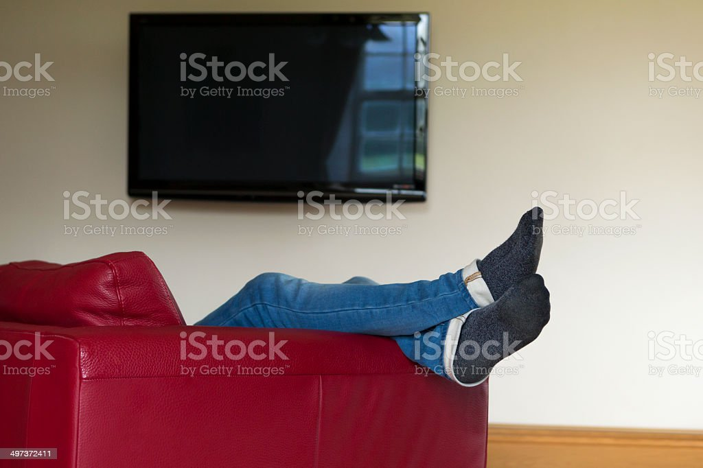 Young Man Relaxing on Sofa stock photo